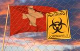 Coronavirus biohazard sign against the Swiss flag. Restricted border crossing or quarantine in Switzerland. Conceptual 3D rendering